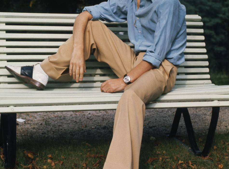 English singer Mick Jagger of the Rolling Stones sitting on a park bench in a panama hat and two-tone shoes, October 1973. (Photo by Anwar Hussein/Hulton Archive/Getty Images)