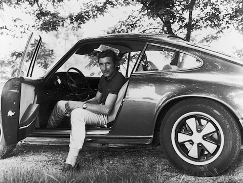 Joseph Siffert au volant de sa Porsche 911 avec son Heuer Autavia réf : 1163T