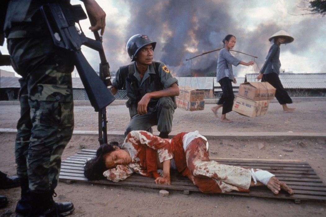 arts_photo_war_20_uk_burrows_larry_1926_1971_pic_bleeding_woman_vietnam_1968_g_28apr2015