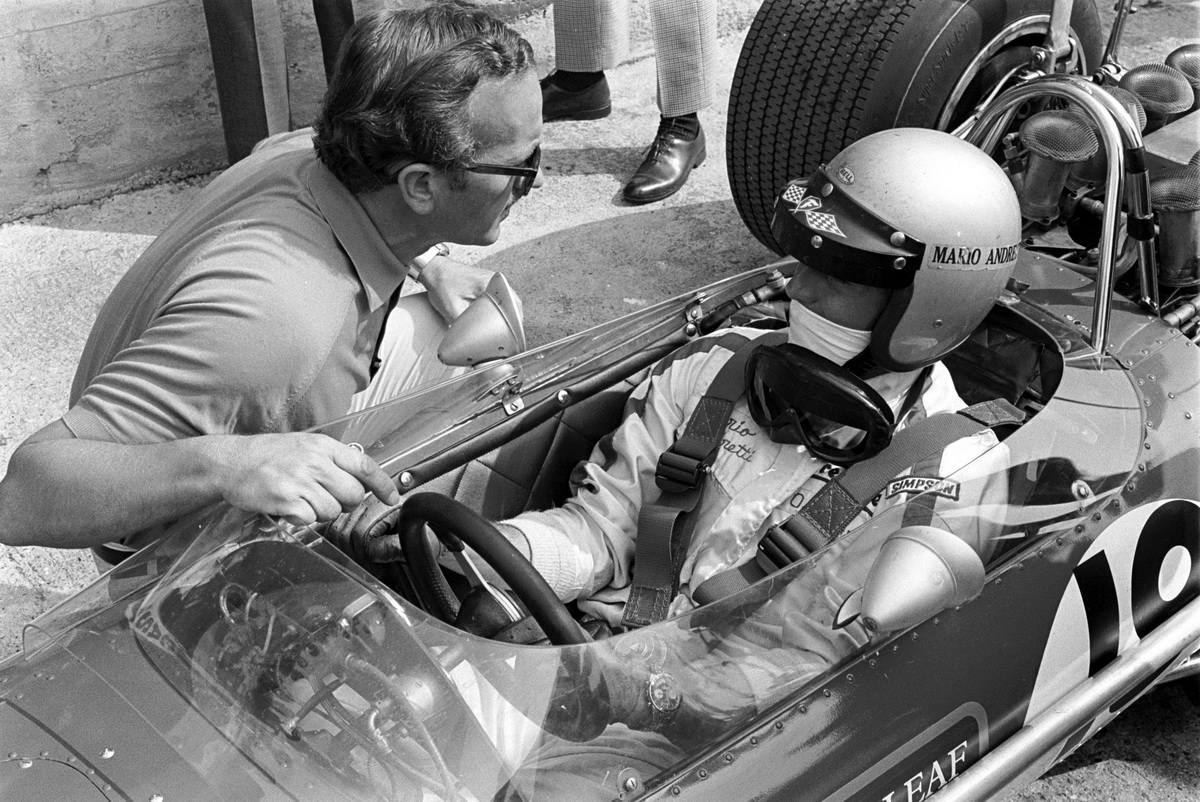 Team Lotus owner Colin Chapman (GBR), left, chats with Mario Andretti (ITA), in car, Lotus 49B who qualified in 21st place but was excluded form the race as he raced In Usa within 24 Hours. Italian Grand Prix, Monza, Italy, 8 September 1968